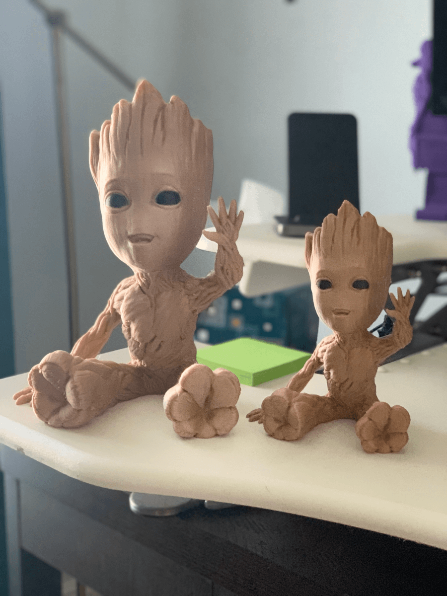 Mini and actual size Groots, printed in wood PLA